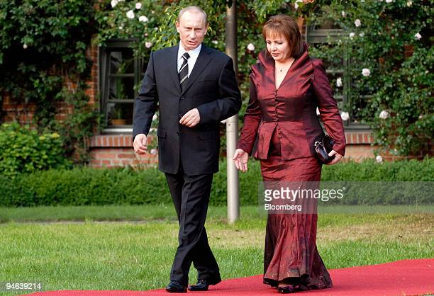 Russian President Vladimir Putin left arrives with his wife Lyudmila Putin for the G8 dinner at Gut Hohen Luckow near Bad Doberan Germany Wednesday...