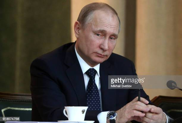 Russian President Vladimir Putin listens during the meeting of the Extended Board of the Prosecutor General's Office on February 15 in Moscow...