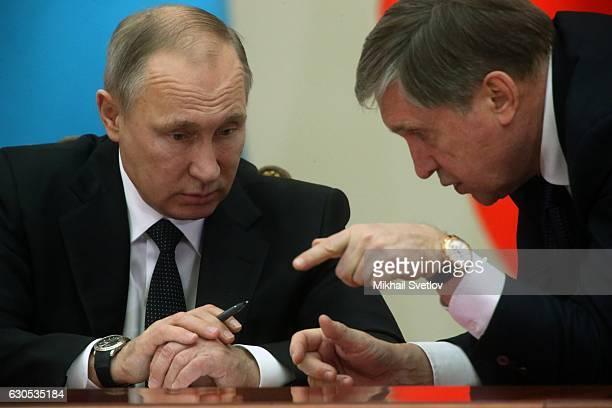 Russian President Vladimir Putin listens his Aide Yuri Ushakov at the Eurasian Economic Union Summit on December 2016 in Saint Petersburg, Russia....