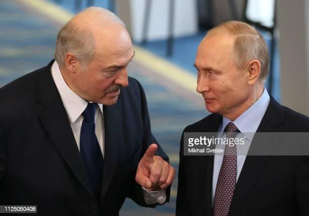 Russian President Vladimir Putin listens to Belarusian President Alexander Lukashenko during their press conference on February 15 2019 in Sochi...