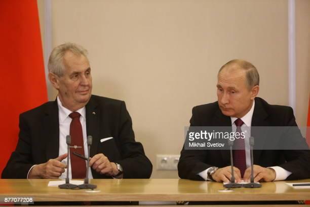 Russian President Vladimir Putin listens to Czech President Milos Zeman during their talks at Black Sea resort state residence of Bocharov ruchey in...