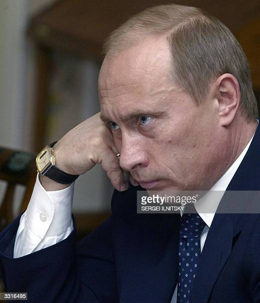 Russian President Vladimir Putin listens to delegates at the international conference 'Liberal Program for the New Century Global Outlook' during...