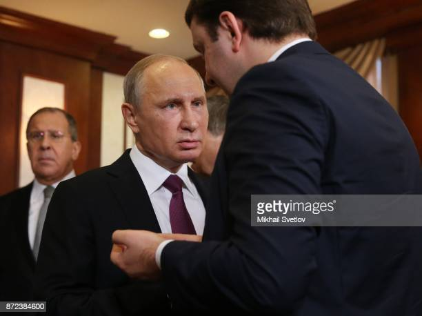 Russian President Vladimir Putin listens to Economic Development Minister Maksim Oreshkin prioir to a bilateral meeting with Philippines President...