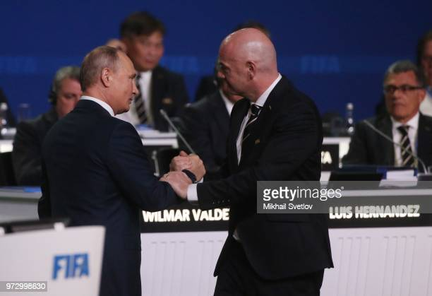 Russian President Vladimir Putin listens to FIFA President Gianni Infantino during the 68th FIFA Congress at the Moscow Expocentre on June 13 2018 in...