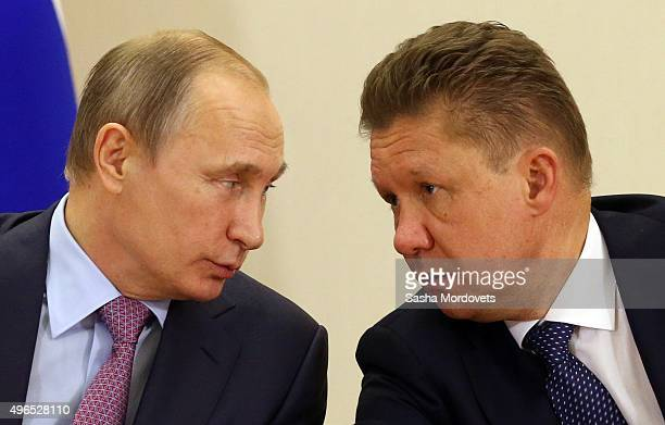 Russian President Vladimir Putin listens to Gazprom CEO Alexei Miller during a RussianKuwait meeting in Bocharov Ruchey State Residence on November...