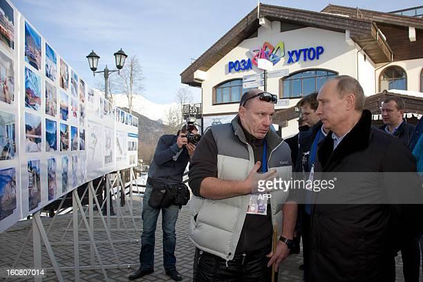 Russian President Vladimir Putin listens to Interros Investment Company President Vladimir Potanin during a visit to the Rosa Khutor Alpine Centre,...