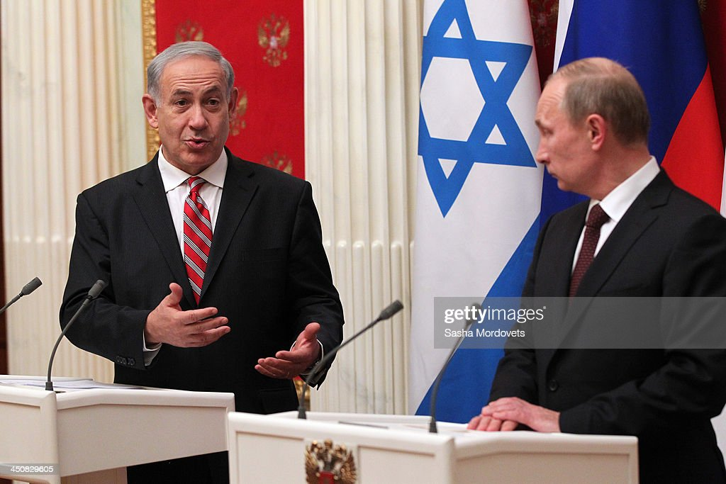 Russian President Vladimir Putin (R) listens to Israeli Prime Minister Benjamin Netanyahu during a meeting in the Kremlin on November 20, 2013 Moscow, Russia. Netanyahu made a one-day visit to Russia to press Putin on a deal concerning Iran's nuclear activities.