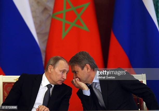 Russian President Vladimir Putin listens to Minister of Agriculture Alexander Tkachyov during his meeting with King of Morocco Mohammed VI in the...