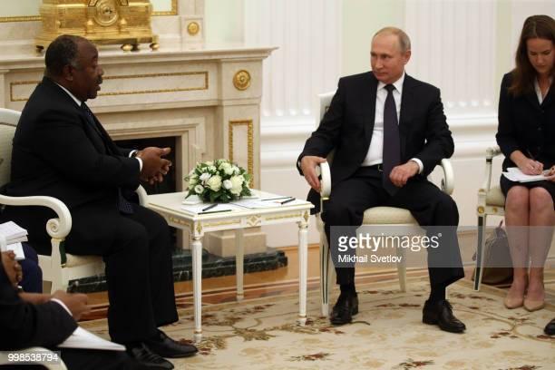 Russian President Vladimir Putin listens to President of Gabon Ali Bongo Ondimba during their talks at the Kremlin in Moscow Russia July2018...