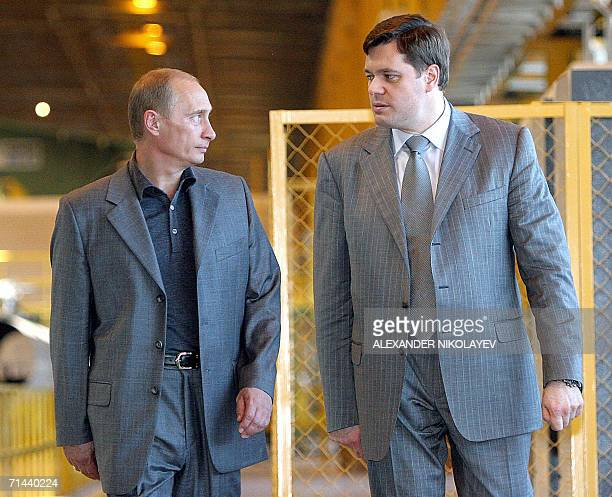 Russian President Vladimir Putin listens to Russian Steelmaker Severstal Chairman Alexei Mordashov as they attend the opening of a tube-rolling plant...