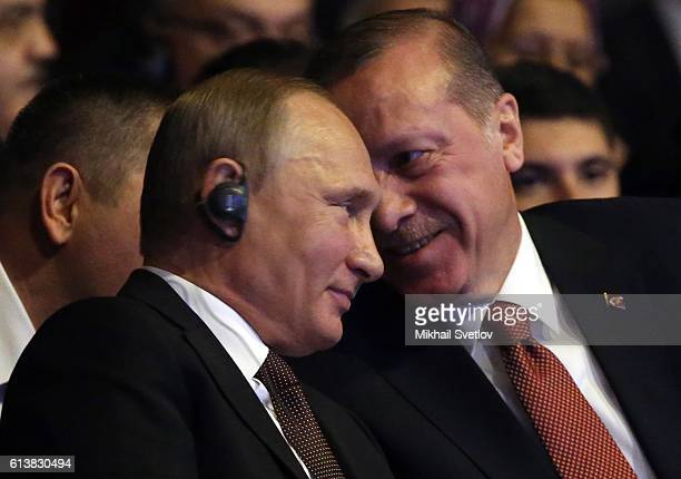 Russian President Vladimir Putin listens to Turkish President Recep Tayip Erdogan during the 23rd World Energy Congress on October 10 2016 in...