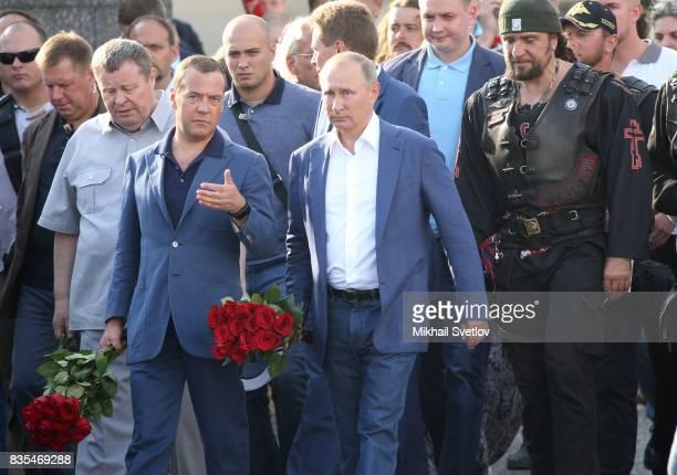 Russian President Vladimir Putin litsnens to Prime Minister Dmitry Mevedev as Night Wolves Bikers Club President Alexander Zaldostanov also known as...