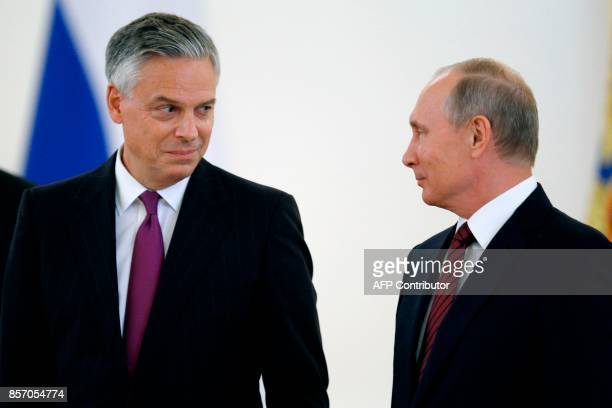 Russian President Vladimir Putin looks at US ambassador to Russia Jon Huntsman during a ceremony of receiving diplomatic credentials from foreign...