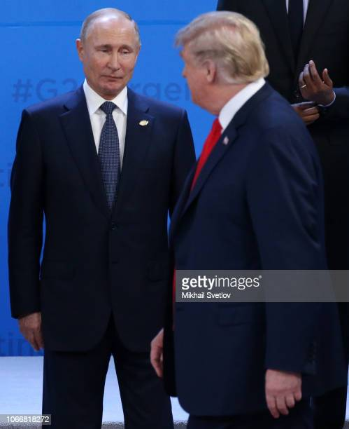 Russian President Vladimir Putin looks at US President Donald Trump during the welcoming ceremony prior to the G20 Summit's Plenary Meeting on...