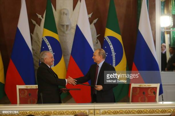 Russian President Vladimir Putin looks on Brazilian President Michel Temer during their meeting at the Grand Kremlin Palace in Moscow Russia June2017...