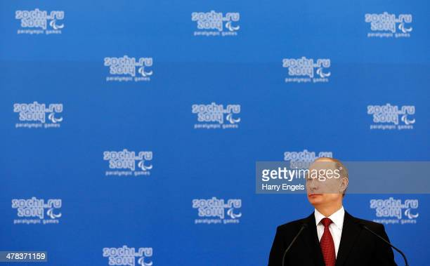 Russian President Vladimir Putin looks on during a lunch hosted by the office of the Russian President Vladimir Putin for the Presidents of the...