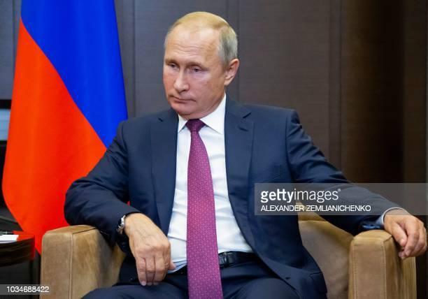 Russian President Vladimir Putin looks on during a meeting with Turkish President Recep Tayyip Erdogan in the Bocharov Ruchei residence in the Black...