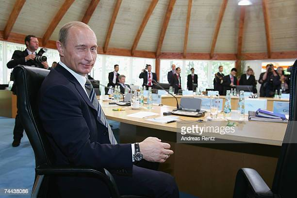 Russian President Vladimir Putin looks on prior to a working session of the G8 leaders and five top developing and African nations on June 8 2007 in...