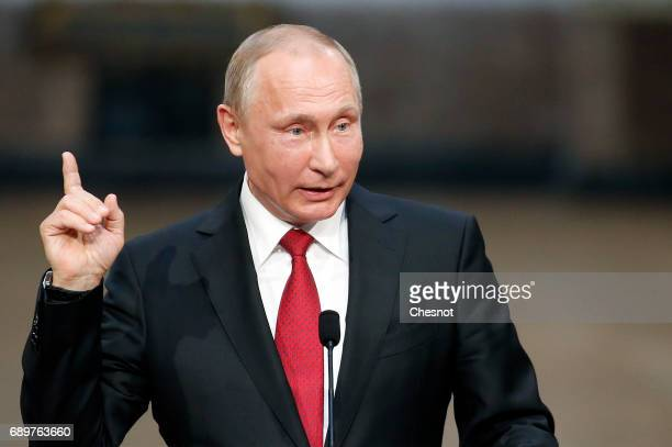 Russian President Vladimir Putin makes a statement during a joint press conference with French President Emmanuel Macron at 'Chateau de Versailles'...