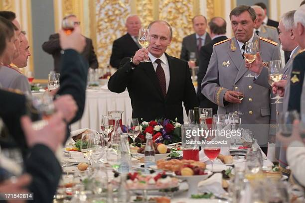 Russian President Vladimir Putin makes a toast as Deputy Defense Minister General Staff ColGen Valery Gerasimov looks on during a reception at the...
