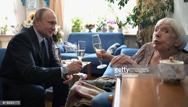 Russian President Vladimir Putin makes a toast with human rights activist Lyudmila Alekseyeva chairperson of the Moscow Helsinki Group on the...