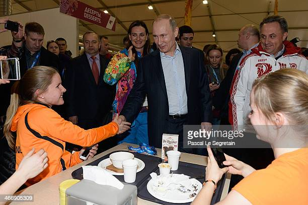 Russian President Vladimir Putin meets athletes while visiting the Coastal Cluster Olympic Village ahead of the Sochi 2014 Winter Olympics on...