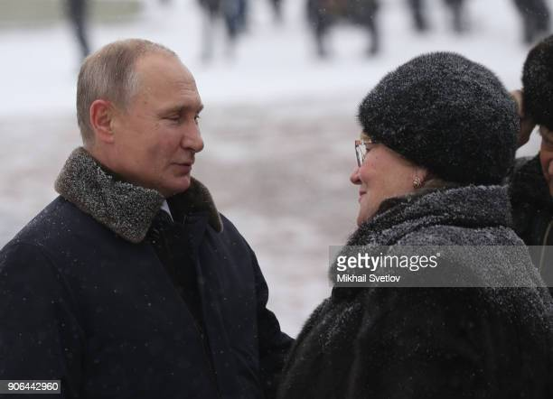 Russian President Vladimir Putin meets local as he commemorates the 75th anniversary of the end of the Siege of Leningrad at Piskaryovskoye cemetery...
