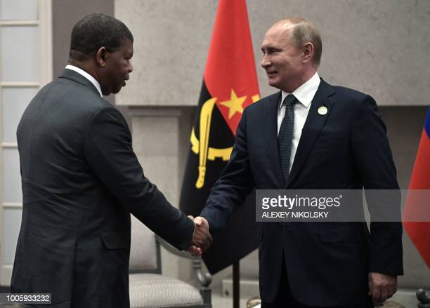 Russian President Vladimir Putin meets with Angola's President Joao Lourenco on the sidelines of the 10th BRICS summit on July 26 2018 in...