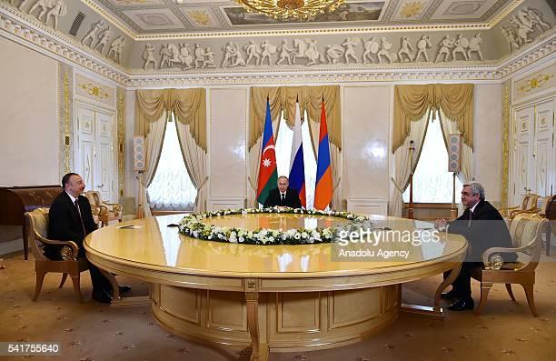 Russian President Vladimir Putin meets with Armenian President Serzh Sargsyan and Azerbaijani President Ilham Aliyev to talk on Nagorno-Karabakh in...