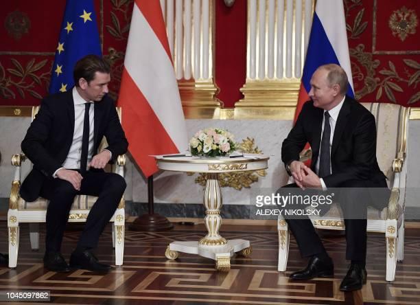 Russian President Vladimir Putin meets with Austrian Chancellor Sebastian Kurz at the State Hermitage Museum in Saint Petersburg on October 3 2018