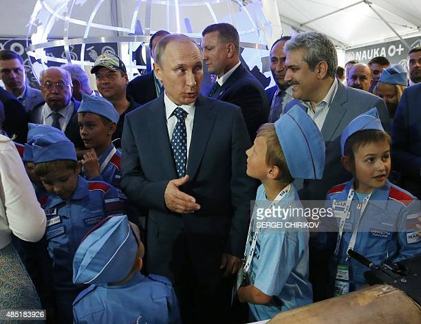 Russian President Vladimir Putin meets with children while visiting the MAKS-2015, the International Aviation and Space Show, in Zhukovsky, outside...
