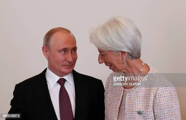 Russian President Vladimir Putin meets with Christine Lagarde, managing director of the International Monetary Fund , at the Konstantin Palace in...