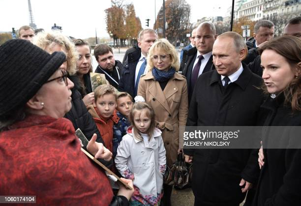 Russian President Vladimir Putin meets with descendants of WWI participants after the flowerlaying ceremony marking the centenary of the Armistice...
