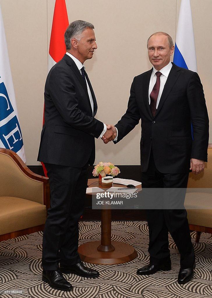 russian president vladimir putin r meets with didier burkhalter l