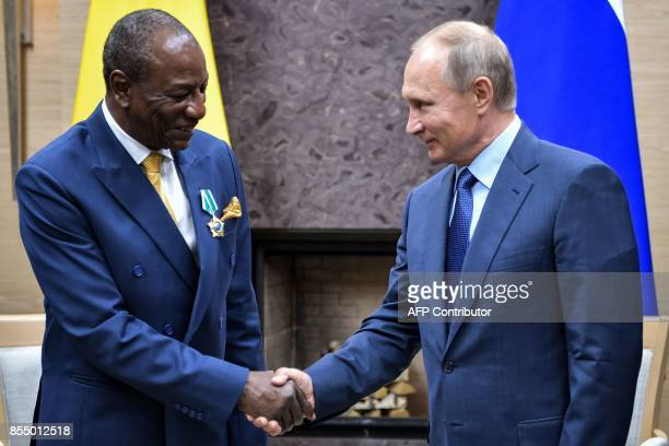Russian President Vladimir Putin meets with Guinean President Alpha Conde at the NovoOgaryovo state residence outside Moscow on September 28 2017 /...