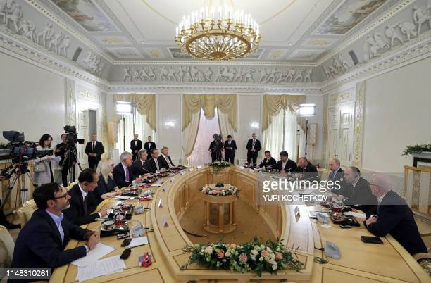 Russian President Vladimir Putin meets with heads of international news agencies on the sidelines of the St. Petersburg International Economic Forum...