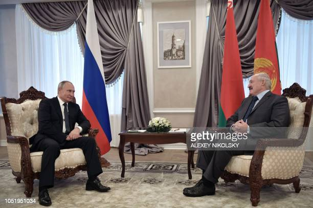 Russian President Vladimir Putin meets with his Belarus' counterpart Alexander Lukashenko in Mogilev on October 12 2018