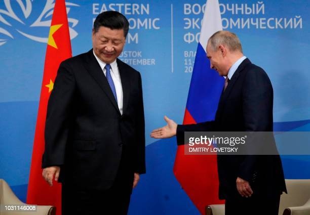 Russian President Vladimir Putin meets with his Chinese counterpart Xi Jinping on the sidelines of the Eastern Economic Forum in Vladivostok on...