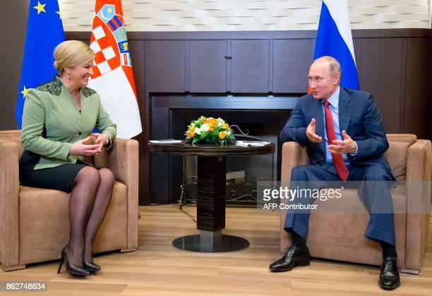 Russian President Vladimir Putin meets with his Croatian counterpart Kolinda GrabarKitarovic at the Bocharov Ruchei state residence in Sochi October...