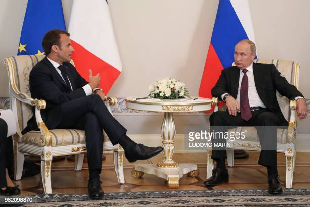 Russian President Vladimir Putin meets with his French counterpart Emmanuel Macron at the Konstantin Palace in Strelna, outside Saint Petersburg, on...
