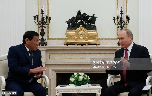 Russian President Vladimir Putin meets with his Philippine counterpart Rodrigo Duterte at the Kremlin in Moscow late on May 23, 2017. / AFP PHOTO /...