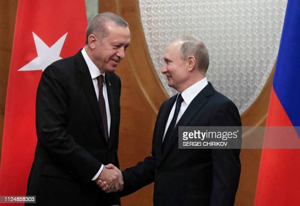 TOPSHOT Russian President Vladimir Putin meets with his Turkish counterpart Recep Tayyip Erdogan in the Black Sea resort of Sochi on February 14 2019