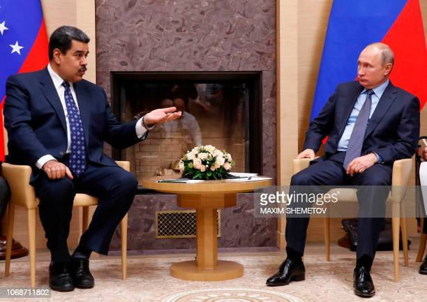 Russian President Vladimir Putin meets with his Venezuelan counterpart Nicolas Maduro at the NovoOgaryovo state residence outside Moscow on December...