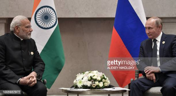 Russian President Vladimir Putin meets with Indian Prime Minister Narendra Modi on the sidelines of the 10th BRICS summit on July 26 2018 in...