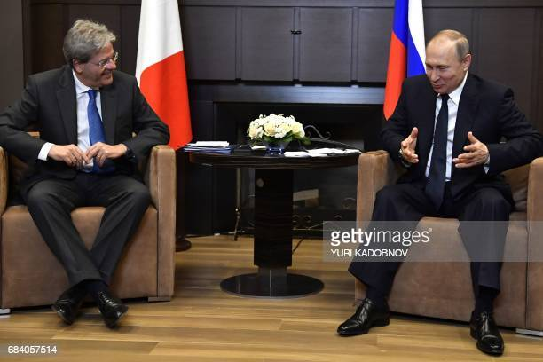 Russian President Vladimir Putin meets with Italian Prime Minister Paolo Gentiloni at the Bocharov Ruchei state residence in Sochi on May 17 2017 /...
