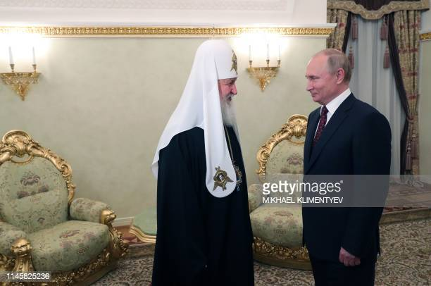 Russian President Vladimir Putin meets with Patriarch Kirill the head of the Russian Orthodox Church to commemorate the day of Saints Cyril and...