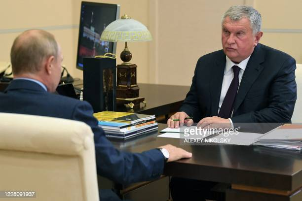 Russian President Vladimir Putin meets with Russia's oil giant Rosneft CEO Igor Sechin at the Novo-Ogaryovo state residence outside Moscow on August...