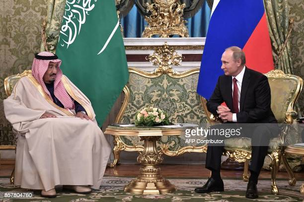 Russian President Vladimir Putin meets with Saudi Arabia's King Salman bin Abdulaziz Al Saud at the Kremlin in Moscow on October 5 2017 / AFP PHOTO /...