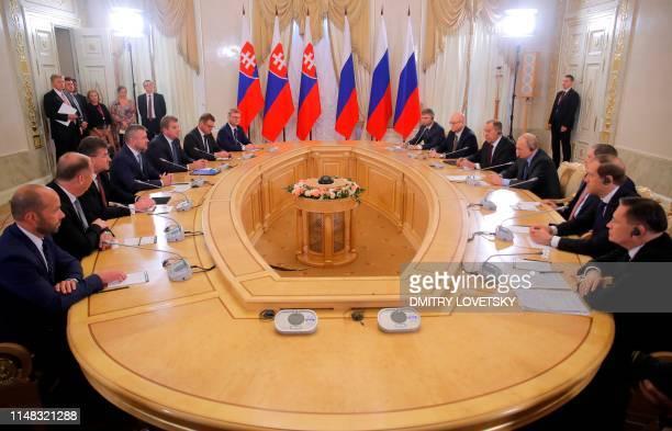 Russian President Vladimir Putin meets with Slovak Prime Minister Peter Pellegrini on the sidelines of the St Petersburg International Economic Forum...