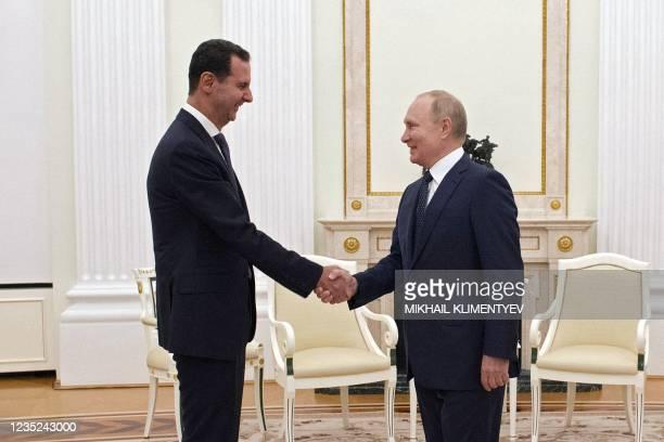 Russian President Vladimir Putin meets with Syrian President Bashar al-Assad at the Kremlin in Moscow on September 13, 2021.